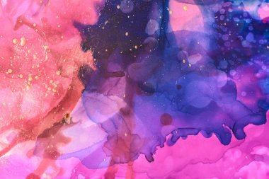 beautiful trendy violet and blue splashes of alcohol inks as abstract background