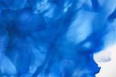 Fotografia blu brillanti spruzzi di inchiostro alcool come astratto