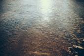 close-up shot of beautiful transparent water in mountain river, Carpathians, Ukraine