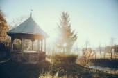 Fotografie beautiful alcove in garden on sunny morning in Vorokhta, Carpathians, Ukraine