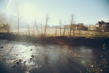 scenic shot of river in Vorokhta town on sunny morning, Carpathians, Ukraine