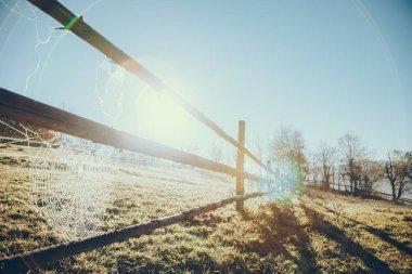 close-up shot of wooden pasture fence with spider web in Vorokhta, Carpathians, Ukraine
