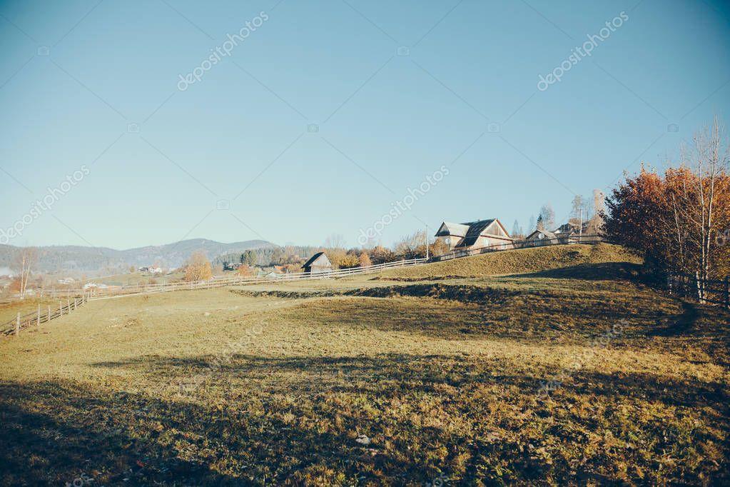 pasture with buildings in mountain Vorokhta town, Carpathians, Ukraine