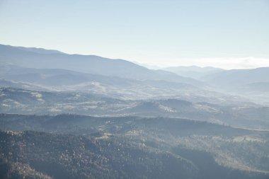 Hazy mountains landscape under blue sky, Carpathians, Ukraine stock vector