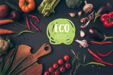 Top view of different vegetables and cutting board on table with eco product lettering stock vector