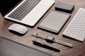 Photo close-up shot of different modern gadgets on cg artist workplace