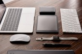 Photo assembled various modern gadgets on wooden table