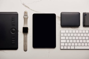 flat lay with various wireless devices on white marble surface