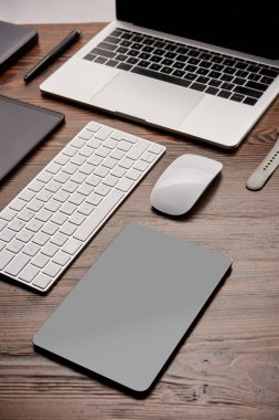 close-up shot of various wireless gadgets on graphics designer workplace