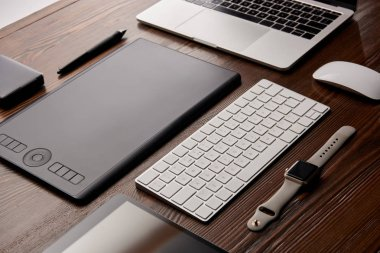 close-up shot of various gadgets on graphics designer workplace