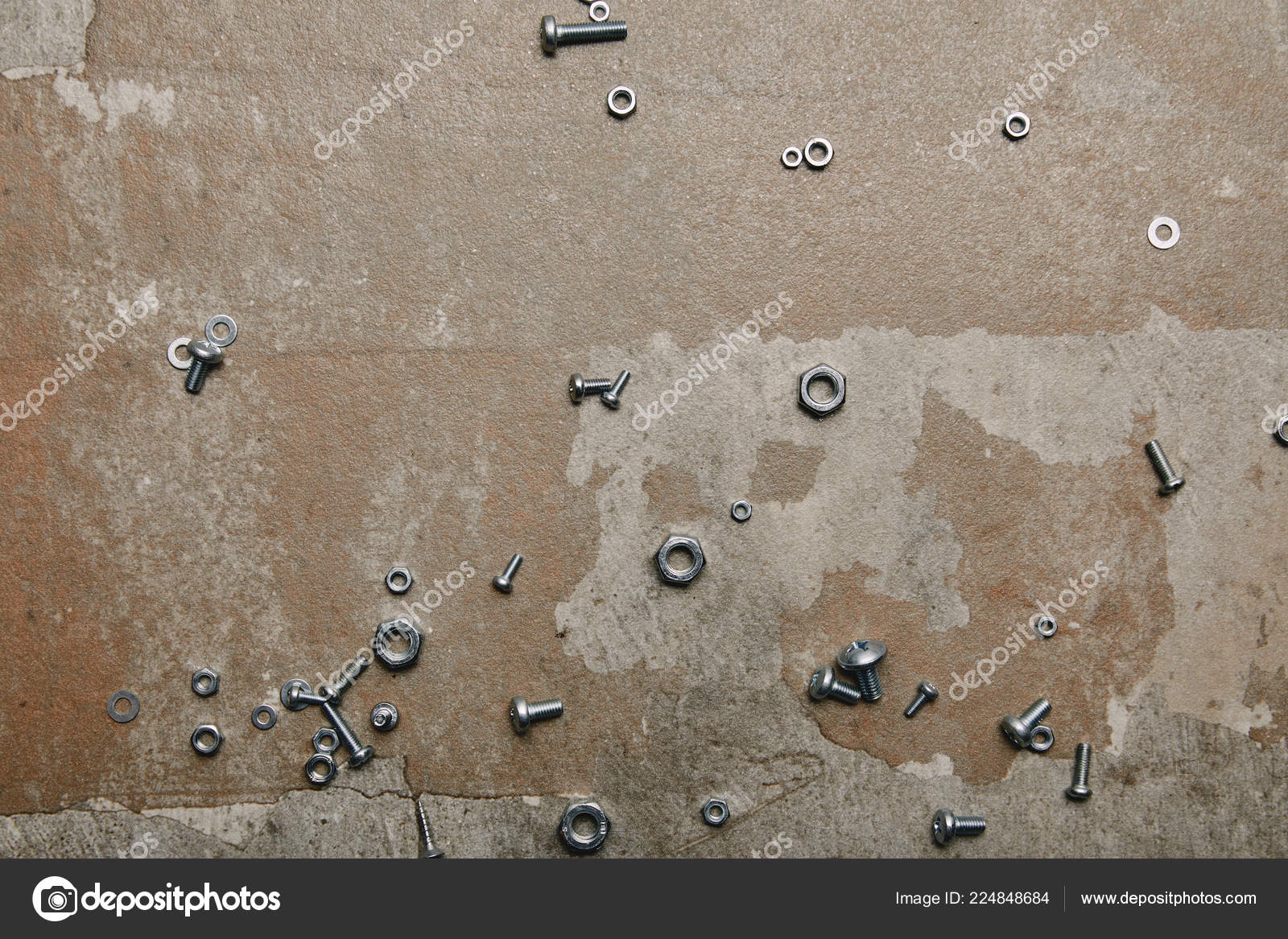 top view screws bolts scattered background old surface stock photo