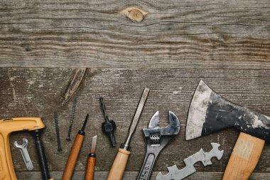Top view of various carpentry tools on wooden background