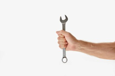 Partial view of man holding wrench isolated on white stock vector