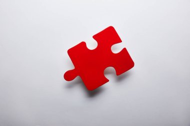 top view of red puzzle problem solution symbol on grey background