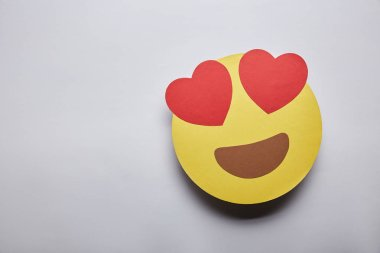 elevated view of in love emoticon on grey background