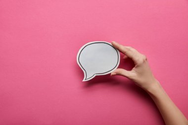 top view of empty white speech bubble on pink background