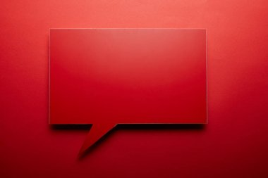 Empty speech bubble in red color on red background stock vector