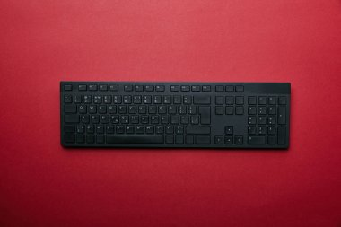 Top view of black computer keyboard on red background stock vector