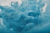 Fotografie abstract texture with blue paint swirls