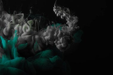 abstract dark background with green and grey splashes of mixing paint