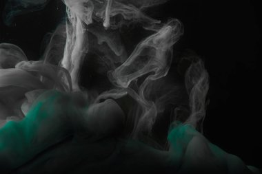 dark background with green and grey swirls of paint