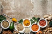 Photo flat lay of superfoods and legumes on textured rustic background with copy space