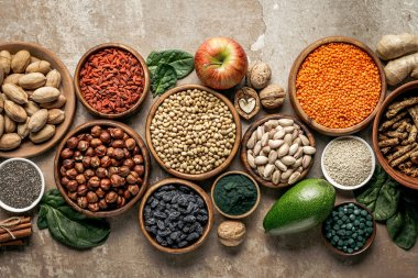 top view of superfoods, legumes and healthy ingredients on rustic background