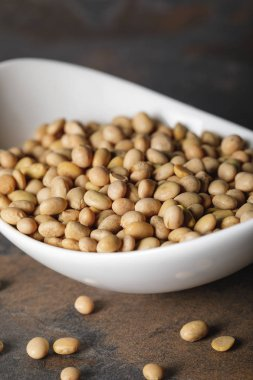 selective focus of soybean in white bowl on table