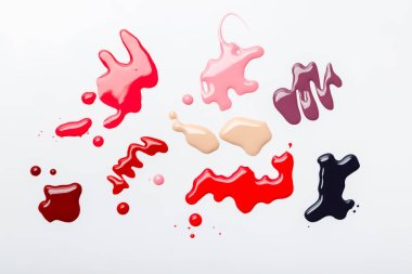 Top view of abstract spills of nail polish with drops isolated on grey stock vector