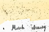Fotografie top view of march and february calendar and golden confetti on beige background