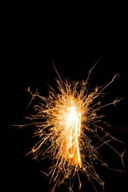 Bright burning christmas sparkler on black background stock vector