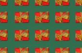 Vánoční bezešvé pozadí s červenými dárkové krabičky s luky