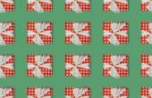 Fotografia Priorità bassa senza giunte di Natale con scatole regalo con pois e fiocchi