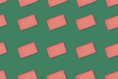 Top view of red wrapped gifts isolated on green background