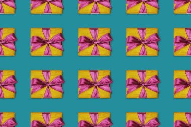 seamless christmas background with gift boxes with bows