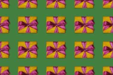 seamless background with christmas gifts with purple bows