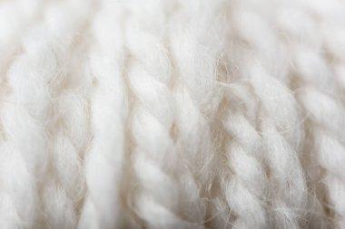 full frame of white knitting texture as backdrop