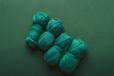 top view of green knitting clews on green background