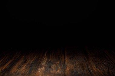 Dark brown striped wooden background on black stock vector