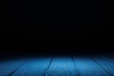 blue striped wooden tabletop on black