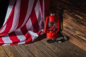 Fotografie american flag, red lantern and compass on wooden surface