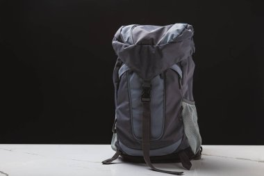 backpack for hiking on black background, travel concept