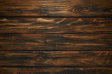 Top view of dark brown wooden background with horizontal planks stock vector