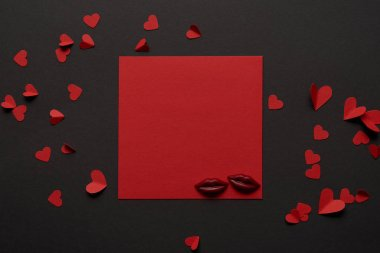 Top view of red empty card with chocolate lips and paper cut hearts stock vector