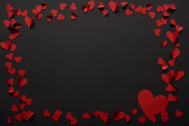 Black background with copy space and paper cut red hearts stock vector