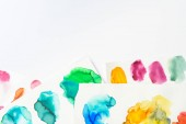 Fotografia top view of abstract watercolor pink, yellow, green and blue spills on white background