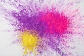 Fényképek fehér alapon, lila, rózsaszín és sárga holi por robbanás felülnézet