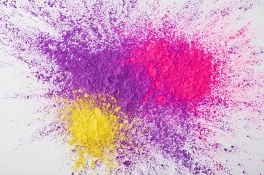 Top view of explosion of purple, pink and yellow holi powder on white background stock vector