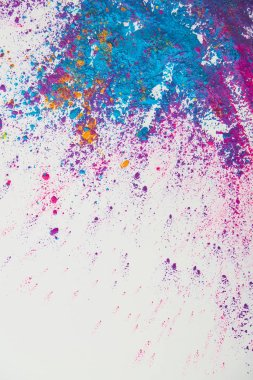 Top view of explosion of purple and blue holi powder on white background stock vector