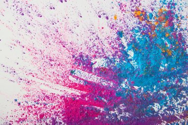 top view of explosion of purple and blue holi powder on white background